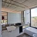 Bathroon with Faucet and Sink Beside the Bathtub in White Color in the House on the Beach
