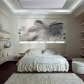 Bedroom with Collactable Displayed on the Shleving with Feather Print and textured Rug Decor