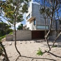 Building in Steel Color in the House on the Beach Surounded by Planters and Tres Also