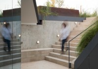 Concrete Staircase Shiny Outdoor Light Metallic Railing Dark Glass Sliding Door