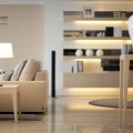 Couch Shiny Table Lamp on Small Side Table Hidden Light on Minimalist Wall Shelves