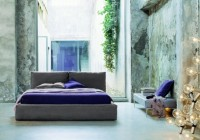 Floor Glass Wall Natural Greenery Cushy Bed with Purple Bedsheet Modern Rectangular Table