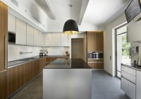 Light Glossy Black Pendant light above Square Island Dark Concrete Floor