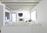 Living Room that White Color Domminant in the at the Villa taht Led Tv Completed the Area