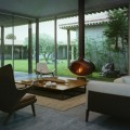 Living Sofas with Brown Chairs and Wooden Table in the Modern Cottage Courtyard Decor