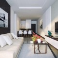 Living Space with Cream Sofas Under the Paint Wall