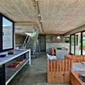 Living and Kitchen Area in House on the Beach Used Wooden Chairs and Table Also