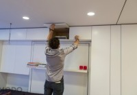Modular Wall System and the Man Showing that Storage One of them Opened