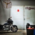 Motorcycles Solid Concrete Floor Old Metallic Fan Tough Metallic Door Dark Leather Sofa