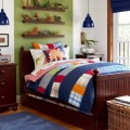 Patchwork Quil Pendant Lit in the Boys Room with Bold Duvet and Glass Windows Showign Outside Area