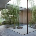 Planters in the Modern Cottage Courtyard Showing Glass Covered the Planters Inspiring Our Decor