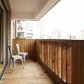 Railing Concrete Cantilever Fresh Indoor Plants Glass Sliding Door Rustic Brick Wall