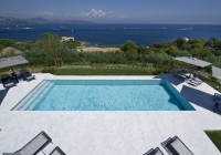 Residence with Large Swimming Pool Dark Lounge Chairs with Grey Canopy