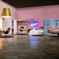 Sleek Concrete Floor Antique Car Minimalist Bookcase Red Acrylic Chairs Gold Pendant Light