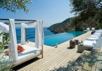 Villa with Curtain in White Color and Orange Pillows in the Villa Eudokia Greece