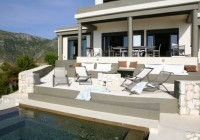 Villa with Loungers in Steel Color and the Pillows Completed the Decor