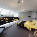 bedroom with fitted storage and black leather armchair